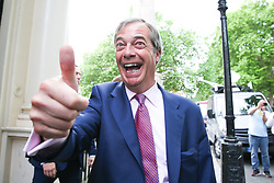© Licensed to London News Pictures. 27/05/2019. London, UK. Nigel Farage, leader of the Brexit Party and a MEP for South East England gives a thumbs up as he arrives at the EU election results press conference in Westminster. The newly formed Brexit Party wants the UK to leave the EU without an agreement won 10 of the UK's 11 regions, gaining 28 seats, more than 32% of the vote across the country and are largest party in nine regions. Photo credit: Dinendra Haria/LNP