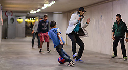14.09.2015, Hauptbahnhof Salzburg, AUT, Fluechtlinge am Hauptbahnhof Salzburg auf ihrer Reise nach Deutschland, im Bild Flüchtlinge beim Fussballspielen in der Parkgarage // Refugees playing football in the parking garage. Thousands of refugees fleeing violence and persecution in their own countries continue to make their way toward the EU, Main Train Station, Salzburg, Austria on 2015/09/14. EXPA Pictures © 2015, PhotoCredit: EXPA/ JFK