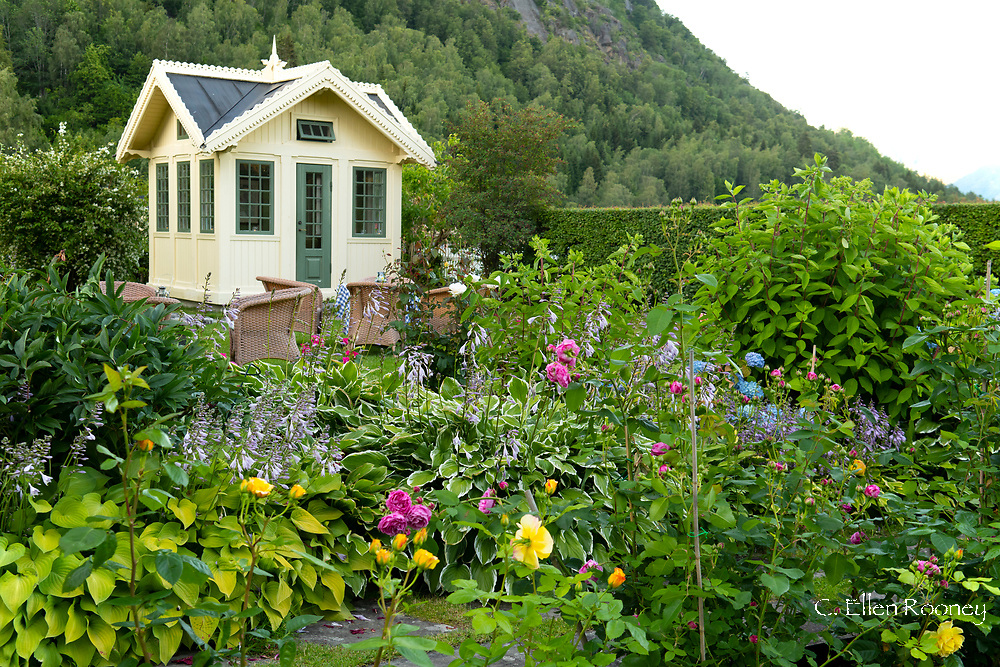 A summer house in the garden of the Walaker Hotell in Solvorn on Lustra Fjord, Vestlandet,  Norway