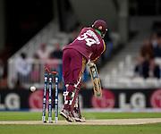 Lendl Simmons is bowled by Angelo Mathews during the ICC World Twenty20 Cup semi-final between Sri Lanka and West Indies at The Oval. Photo © Graham Morris (Tel: +44(0)20 8969 4192 Email: sales@cricketpix.com)