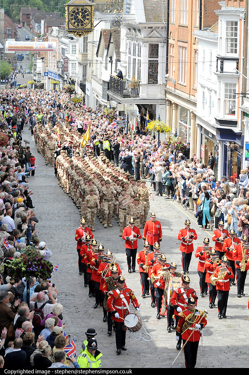 """The Troops marched up the High Street cheered by thousands who had come to watch. Shops stopped trading and staff came out on to the streets. Cheering and applause could be heard...Residents and visitors to Guildford will have the chance to welcome home troops from the 1st Battalion Princess of Wales's Royal Regiment next week when they march through the town centre following their return from Iraq and Afghanistan...The Homecoming Parade, organised by Guildford Borough Council, will take place on Wednesday 15 July.  Around 200 soldiers from the local Regiment, also known as 'The Tigers', will set off from Millmead and parade through Guildford with the Kohima Band of the 3rd Battalion.  The Mayor of Guildford will host a reception at Holy Trinity Church for the troops, veterans and cadets...    Says Mayor of Guildford, Cllr Pauline Searle: """"Guildford warmly welcomes the 1st Battalion Princess of Wales's Royal Regiment home.  The Regiment has been historically associated with Guildford for many years and the troops are now in a position to exercise the Freedom of the Borough transferred to them in 1992.  We hope as many people as possible will come along to watch the parade and celebrate this special occasion""""...    Queen's Royal Surrey Regiment veteran Kenneth Honeyman, 93, adds: """"As a younger man I always attended the 5th Queen's Members' Association Open Days and marched through Guildford.  The parade will give me the opportunity to meet up with the few surviving old members and pay tribute to the soldiers who serve our country today""""...The salute will be taken by Guildford born and bred Colonel Patrick Crowley, the Vice-Lord Lieutenant Gordon Lee-Steere DL, and the mayor.  Two soldiers will be presented with medals by the mayor during the parade.  Private Bill Maguire, 18, from Guildford, who has served with the Battalion for two years will be awarded an operational tour medal for service in Iraq.  Following six years' service with the Battalion, Lance Corporal Ky"""