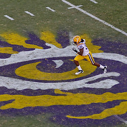 October 8, 2011; Baton Rouge, LA, USA; LSU Tigers safety Derrick Bryant (36) runs over the eye of the tiger logo at midfield during the fourth quarter against the Florida Gators at Tiger Stadium. LSU defeated Florida 41-11. Mandatory Credit: Derick E. Hingle-US PRESSWIRE / © Derick E. Hingle 2011