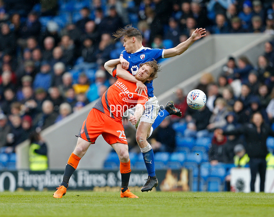 Wycombe Wanderers Craig Mackail-Smith(25) and Chesterfield's Sid Nelson(35) contest an aerial ball  during the EFL Sky Bet League 2 match between Chesterfield and Wycombe Wanderers at the b2net stadium, Chesterfield, England on 28 April 2018. Picture by Paul Thompson.