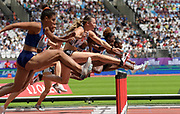 Jul 20, 2019; London, United Kingdom; Nia Ali (USA), center, runs in a women's 100m hurdles heat during the London Anniversary Games at London Stadium at  Queen Elizabeth Olympic Park.