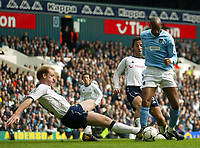 Photo: Scott Heavey.<br /> Tottenham Hotspur v Manchester City. FA Barclaycard Premiership. 12/04/2004.<br /> Gary Doherty fails to clear from Nicolas Anelka allowing him to score