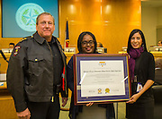 Chief Robert Mock and staff display their Commission on Accreditation for Law Enforcement Act (CALEA) award certification during a meeting of the Houston ISD Board of Trustees, December 8, 2016.