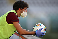 A ball boy holds an official match ball wearing protective gloves and a face mask during the Serie A match at Stadio Grande Torino, Turin. Picture date: 20th June 2020. Picture credit should read: Jonathan Moscrop/Sportimage