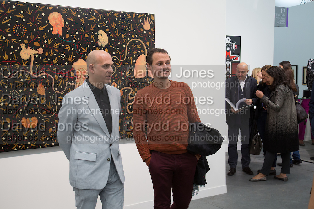 STEVE LAZARIDES; JONATHAN YEO, The VIP preview of Frieze. Regent's Park. London. 16 October 2013
