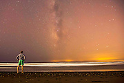 Marbella, SPAIN:  04.09.15 A holiday maker on the south coast of Spain looks across the Mediterranean Sea toward the lights of Morocco cast under the Milky Way. One of the many routes used by the refugees in the long running crisis include crossing over to Spain from Morocco. Rick Findler / Story Picture Agency