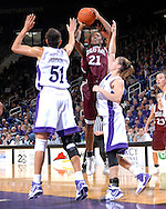Texas A&M guard Morenike Atunrase (21) puts up a shot in the first half against pressure form Kansas State's Marlies Gipson (51) and Shalee Lehning (5) at Bramlage Coliseum in Manhattan, Kansas, January 6, 2007.  K-State upset 17th ranked Texas A&M 48-45.