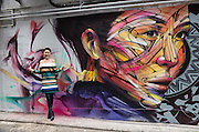 "Wall painting by Parisian street artist Alexandre Monteiro aka Hopare of Hong Kong actress and canto pop star Niki Chow (pictured)<br /> ""Walls of Change"" street art in Hong Kong ahead of the The ""Hope for Wildlife"" Gala Dinner painted to raise awareness for the plight of endangered animals the world over.<br /> Sai Yin Pun Hong Kong<br /> 10th November 2016. Photo by Jayne Russell"