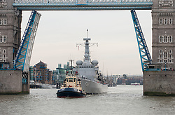 Belgian Navy Frigate Louise Marie coming through Tower Bridge, open in Salute, the Belgian Navy Frigate Louise Marie brings soil from the battlefields of Flanders which will form a memorial garden at the Guards Museum, London, United Kingdom. Friday, 29th November 2013. Picture by i-Images