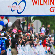 Luke Keough of team UnitedHealthcare Pro Cycling gestures victory as he crosses the finish line & wins the Seventh Annual Wilmington Grand Prix Saturday, May 18, 2013 in Wilmington, Del..