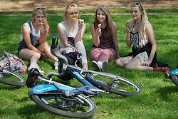 © licensed to London News Pictures. London, UK 22/05/2012. Lottie Boyd, Danielle Carruthers, Isabel Gamble and Jess Corell (left to right) enjoying sunshine with ice-creams in Hyde Park today as the sunshine and hot weather comes to London (22/05/12). Photo credit: Tolga Akmen/LNP