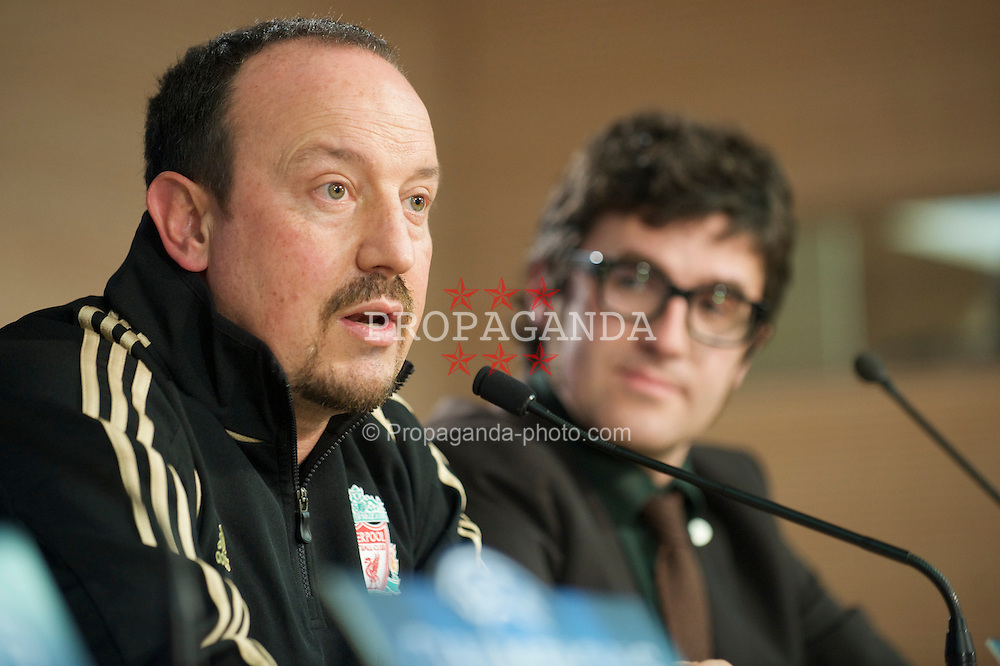 MADRID, SPAIN - Tuesday, February 24, 2009: Liverpool's manager Rafael Benitez during a press conference at the Santiago Bernabeu with a translator who looks like Elvis Costello ahead of the UEFA Champions League First Knock-Out Round against Real Madrid. (Photo by David Rawcliffe/Propaganda)