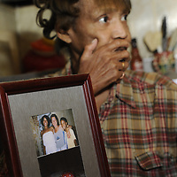 Sandy Drain talks about the disappearance of her niece Gloria Walker, pictured in frame, at her home in Cleveland on Wednesday November 4, 2009. Walker has been missing since May 20, 2007...