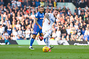 Liam Cooper of Leeds United (6) passes the ball during the EFL Sky Bet Championship match between Leeds United and Bolton Wanderers at Elland Road, Leeds, England on 23 February 2019.