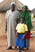 Balila with her parents outside their home in Tinguri, northern Ghana.