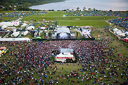 "Fatboy Slim plays the main stage, as seen from the Giant Wheel, on Saturday at Rockness 2013, the annual music festival which took place in Scotland at Clune Farm, Dores, on the banks of Loch Ness, near Inverness in the Scottish Highlands. The festival is known as ""the most beautiful festival in the world"" ."