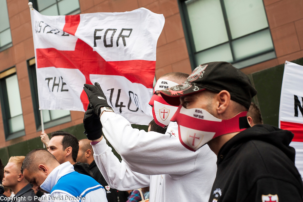 "Rotherham England<br /> 13 September 2014 <br /> EDL members outside Rotherham Main Street Police station where they held a rally as part of the English Defence Leagues ""Justice for the Rotherham 1400"" March described by an EDL Facebook Page as ""a protest against the Pakistani Muslim grooming gangs"" on Saturday Afternoon <br /> <br /> <br /> Image © Paul David Drabble <br /> www.pauldaviddrabble.co.uk"