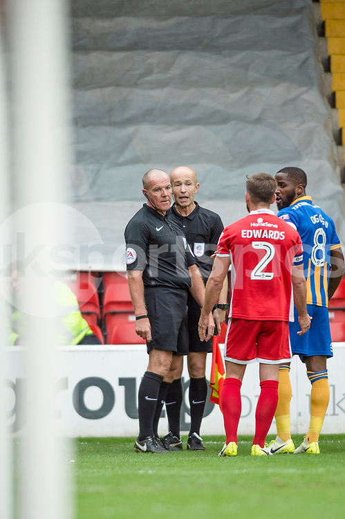 Match Referee Graham Salisbury consults his assistant after his initial decision to award a penalty to Shrewsbury during the EFL Sky Bet League 1 match between Walsall and Shrewsbury Town at the Banks's Stadium, Walsall, England on 7 October 2017. Photo by Darren Musgrove.