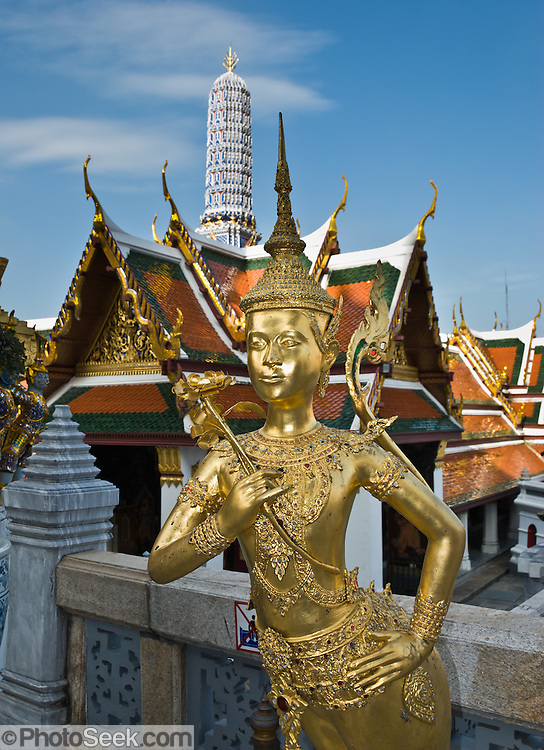 A Thai thepnorasi golden statue has the upper body of a male angel and lower body of a lion (singha), at the Temple of the Emerald Buddha (Wat Phra Kaew), within the grounds of the Grand Palace, Bangkok, Thailand. A thepnorasi is one of many mythical animals from the Himapan (or Himmapan, Himaphan in Thai), a legendary forest which includes a pantheon of amazing creatures and surrounds the base of Mount Meru in Hindu mythology of ancient India (where the mythic forest is called Himmavanta,  Himavanta, or Himavamsa).