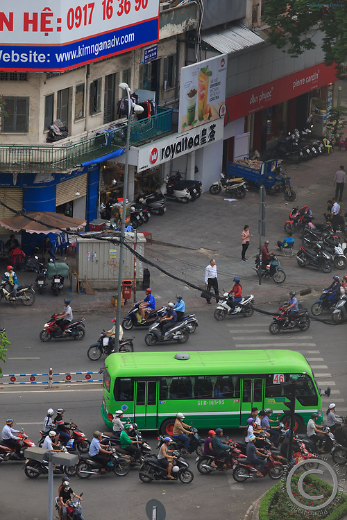 Crazy traffic at a crowded intersection in District 1 of Ho Chi Minh City, Vietnam