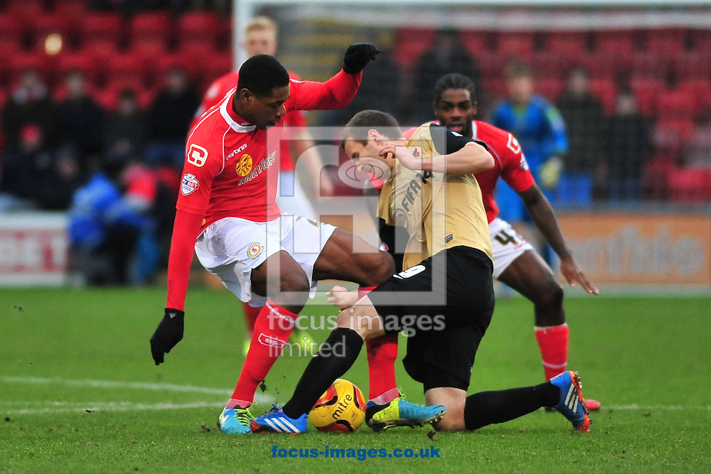 Picture by Ste Jones/Focus Images Ltd +44 7706 592282<br /> 18/01/2014<br /> Chuks Aneke of Crewe Alexandra battles with Jamie&nbsp;Ness of Leyton Orient during the Sky Bet League 1 match at Alexandra Stadium, Crewe.
