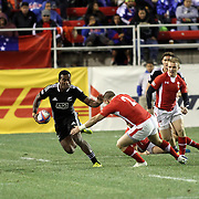 NZ Sevens' Tomasi Cama straight arms Wales Rhys Jones as he breaks for a try at the USA Sevens Rugby at Sam Boyd Stadium, Las Vegas, Nevada, USA.  Photo by Barry Markowitz, 2/8/13