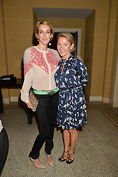 Left to right, SARAH WOODHEAD and ANOUSCHKA MENZIES at the Sindika Dokolo Art Foundation Dinner held at The Cafe Royal, Regent Street, London on 18th October 2014.