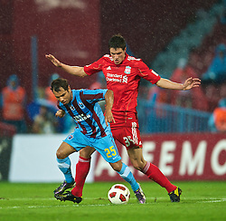 TRABZON, TURKEY - Thursday, August 26, 2010: Liverpool's Martin Kelly in action against Trabzonspor's Alanzinho during the UEFA Europa League Play-Off 2nd Leg match at the Huseyin Avni Aker Stadium. (Pic by: David Rawcliffe/Propaganda)
