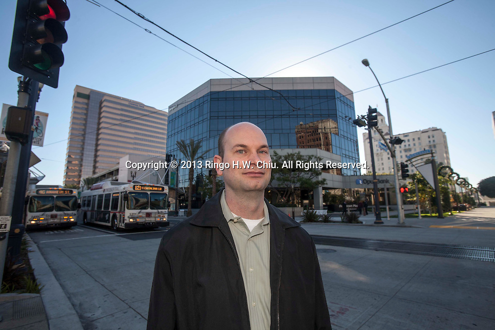 Derek Burnham, Planning Officer at City of Long Beach, is photographed at downtown Long Beach.(Photo by Ringo Chiu/PHOTOFORMULA.com)