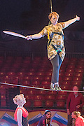 © Licensed to London News Pictures. 22/04/2015. Guildford, UK. Kelly Maire Blunder is guided through the process by comedy artist Vladimir Georgieski and high wire walker Olga Roxhkovskaya. Liberal Democrat Kelly-Marie Blundell walks the high wire at Moscow State Circus in Guildford. Photo credit : Stephen Simpson/LNP