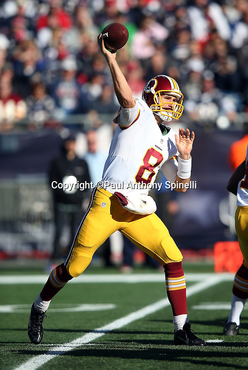 Washington Redskins quarterback Kirk Cousins (8) throws a first quarter passed that gets tipped and intercepted by New England Patriots cornerback Logan Ryan (26) giving the Patriots a first down at the Washington Redskins 26 yard line during the 2015 week 9 regular season NFL football game against the New England Patriots on Sunday, Nov. 8, 2015 in Foxborough, Mass. The Patriots won the game 27-10. (©Paul Anthony Spinelli)