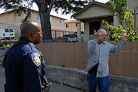 Salinas police officers Jeffrey Lofton listens to a resident of Fremont Street, part of the CASP coverage area. The Community Alliance for Safety and Peace is an ambitious program that aims to steer youth away from gang violence and toward solutions offered by more than 30 local organizations offering alternatives.