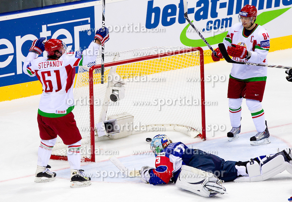 Andrei Stepanov of Belarus and Mikhail Grabovski of Belarus celebrate when they scored vs Robert Kristan, goalkeeper of Slovenia during ice-hockey match between Slovenia and Belarus of Group G in Relegation Round of IIHF 2011 World Championship Slovakia, on May 8, 2011 in Orange Arena, Bratislava, Slovakia. Belarus defeated Slovenia 7-1 and stays in Elite Group A. (Photo By Vid Ponikvar / Sportida.com)