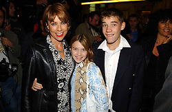 Writer KATHY LETTE and her children GEORGIE ROBERTSON and JULIUS ROBERTSON at the opening night of the musical Murderous Instincts at The Savoy Theatre, London on 7th October 2004.<br /><br />NON EXCLUSIVE - WORLD RIGHTS