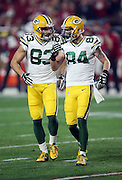 Green Bay Packers wide receiver Jeff Janis (83) celebrates with Green Bay Packers wide receiver Jared Abbrederis (84) after Janis catches a second quarter pass during the NFL NFC Divisional round playoff football game against the Arizona Cardinals on Saturday, Jan. 16, 2016 in Glendale, Ariz. The Cardinals won the game in overtime 26-20. (©Paul Anthony Spinelli)