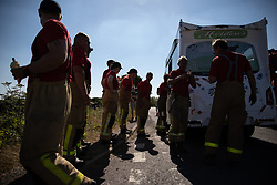 © Licensed to London News Pictures . 03/07/2018. Bolton, UK. A local ice cream firm provides free ice creams to firefighters working on Winter Hill in high temperatures . Fire-fighters continue to work to contain large wildfires spreading across Winter Hill as very high temperatures , changing winds and dry peat continue to exacerbate the problem . Photo credit: Joel Goodman/LNP