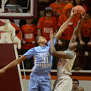 Carolina forward John Henosn blocks Virginia Tech forward C.J. Barksdale in the first half of Carolina's 82-68 win over Virginia Tech Thursday night in Cassell Coliseum. Henson led the Tar Heels with 6 blocks.