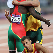 Disabled athlete Oscar Pistorius, South Africa, swaps name tags with  world champion Kirani James,  Grenada, after competing in the Men's 400m semi Finals at the Olympic Stadium, Olympic Park, Stratford at the London 2012 Olympic games. London, UK. 5th August 2012. Photo Tim Clayton