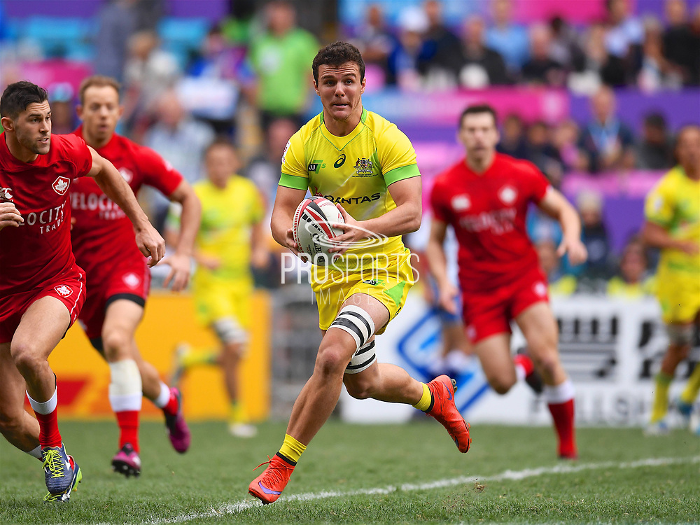Australian player Dylan Pietsch looks to pass the ball during the game Australia vs Canada during the Cathay Pacific/HSBC Hong Kong Sevens festival at the Hong Kong Stadium, So Kon Po, Hong Kong. on 7/04/2018. Picture by Ian  Muir.