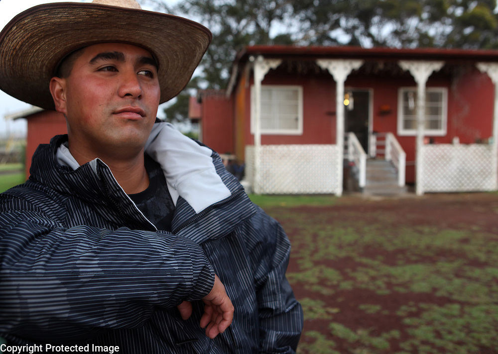 "Fourth generation cowboy, Jessie Ho'opai, is photographed outside the home he lives in on Parker Ranch in Waimea, Hawaii.  ""I was born and raised in this house on Parker Ranch and now me and my wife are raising our two kids in this same house.  I just love the way we were raised and the way we respect ourselves and the land and the animals that we raise here.  There's not too many cowboys left and I'm glad that I still have the privelege to be one or work as one,"" says Ho'opai.  Ho'opai is one of only 12 remaining cowboys left on Parker Ranch which is one of the oldest and largest cattle ranches in the United States."