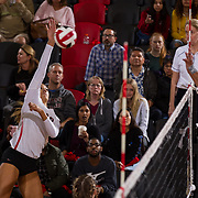 09 November 2017:  The San Diego State Aztecs women's volleyball team hosts UNLV Thursday night at Peterson Gym. San Diego State outside hitter Alexis Cage (18) spikes the ball during a game against UNLV. The Aztecs won 3-1 (25-18; 16-25; 25-12; 25-13).<br /> www.sdsuaztecphotos.com