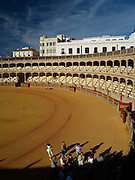 A tour group gets a guided tour of the Ronda Bullring, Ronda (Andalusia), Spain. It is said that this bullring is the birthplace of modern bull fighting.