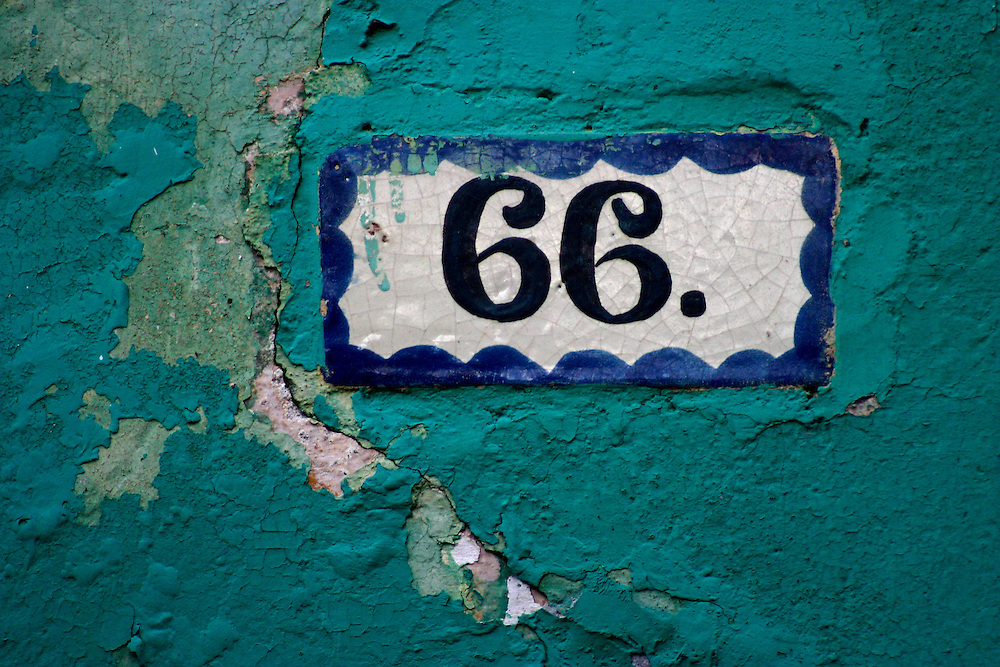 Tile street address in old wall, Mexico