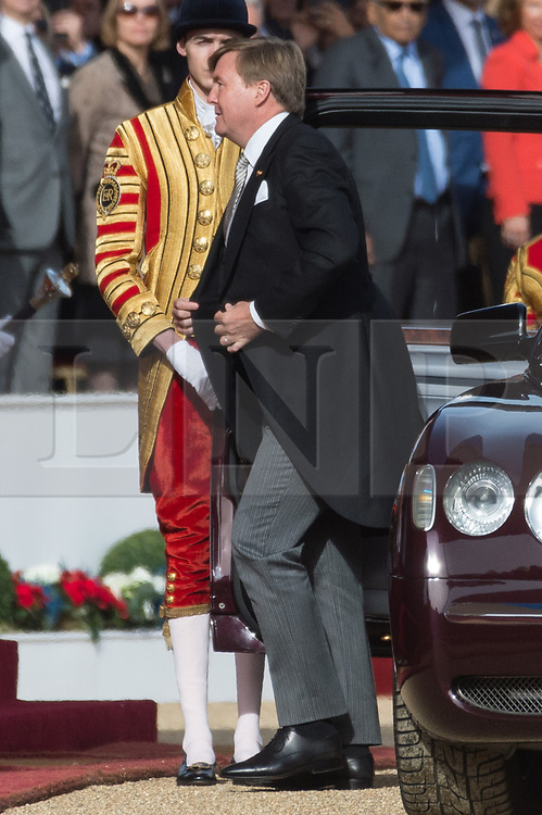 © Licensed to London News Pictures. 23/10/2018. London, UK. His Majesty King Willem-Alexander of the Netherlands, accompanied by Her Majesty Queen Maxima receive a ceremonial welcome at Horse Guard Parade.Photo credit: Ray Tang/LNP