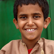 """Oman, Ra's al-Hadd. January/23/2008...The smile of young boy in the fishing village of Ra's al-Hadd. """"There's a sense of pride reflected in the faces of Oman's population - from elders in a small fishing village that enjoy universal healthcare, to the smiles of their grandchildren, for whom tertiary education is now not only free, but encouraged."""""""