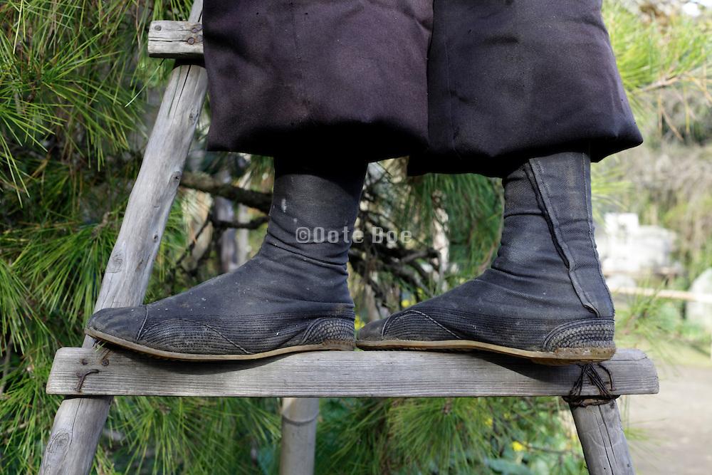 gardener wearing traditional jika tabi shoes Japan