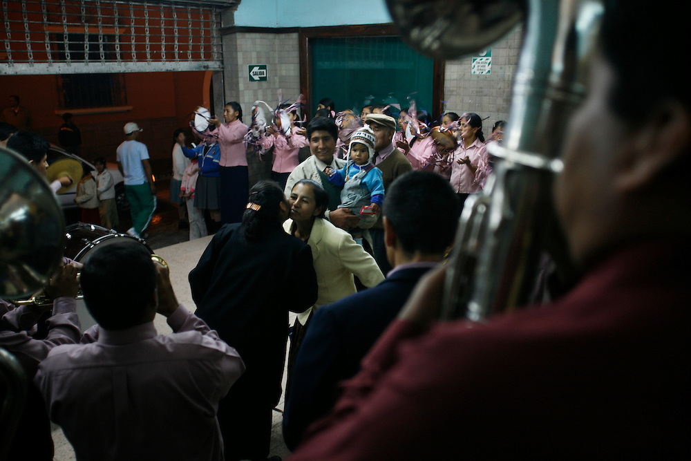 A feverish Christian revival in the mountain city of Ayacucho, Peru, (lat -13.1548°, long -74.2044°, Altitude: 9,202 Feet) where there are high number of processions and Catholic churches, peaking out with the holy week of Semana Santa in May (overly dramatic promotional video - http://www.youtube.com/watch?v=6pwdhC_xu-w). This particular revival was held in an auditorium, with a full marching band and a tambourine choir calling for people to come in and join in the worship service. Unknowing, we wandered in to the scene and found ourselves caught in the madness.